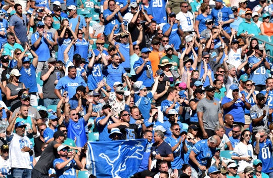 Detroit Lions fans cheer against the Miami Dolphins at Hard Rock Stadium, Oct. 20, 2018 in Miami, Fla.