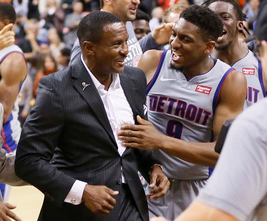 Langston Galloway celebrates a last-second win over the Raptors with Dwane Casey, Nov. 14, 2018.