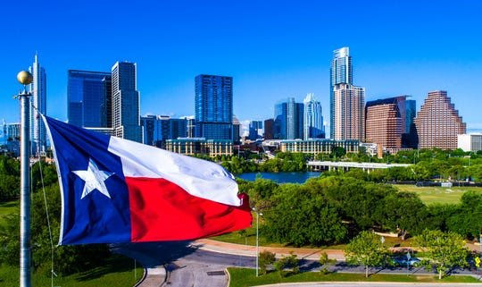 The Texas flag flies.