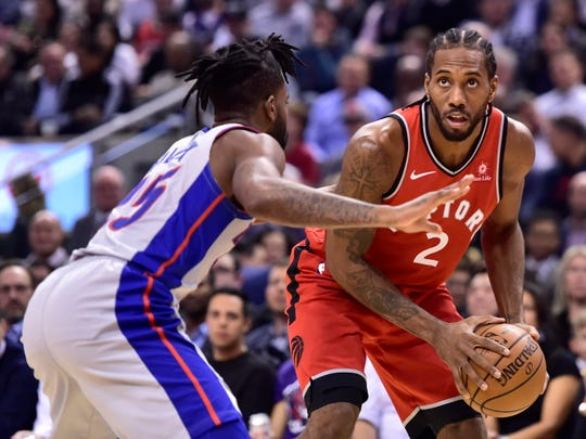 Toronto Raptors forward Kawhi Leonard (2) looks toward the basket as Detroit Pistons guard Reggie Bullock (25) defends during the first half of an NBA basketball game Wednesday, Nov. 14, 2018, in Toronto.