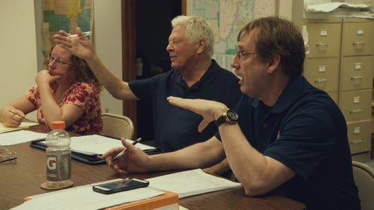 "A town council meeting in the film ""Monrovia, Indiana."""