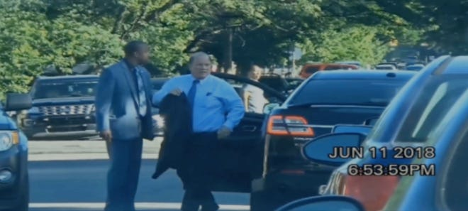 In this frame from secretly recorded video, Mayor Mike Duggan is shown leaving a meeting at Messiah Baptist Church in Detroit on June 11.  It is one of the few frames that clearly identify the mayor.
