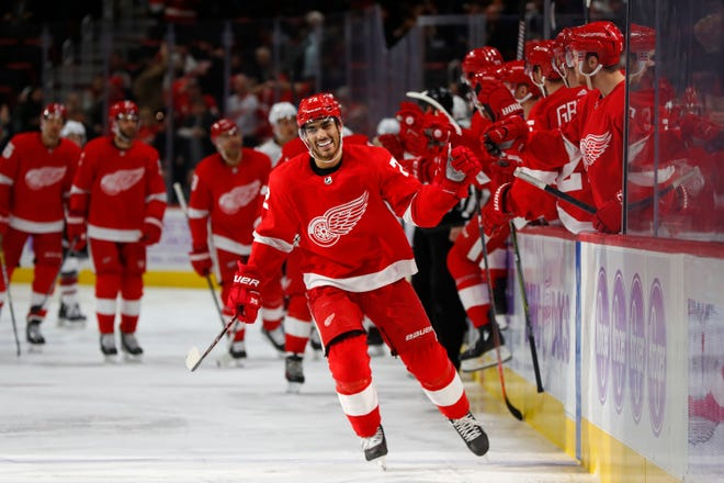 Red Wings center Andreas Athanasiou celebrates his goal against the Coyotes Tuesday.