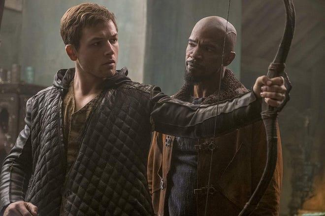 "Taron Egerton and Jamie Foxx in ""Robin Hood."""