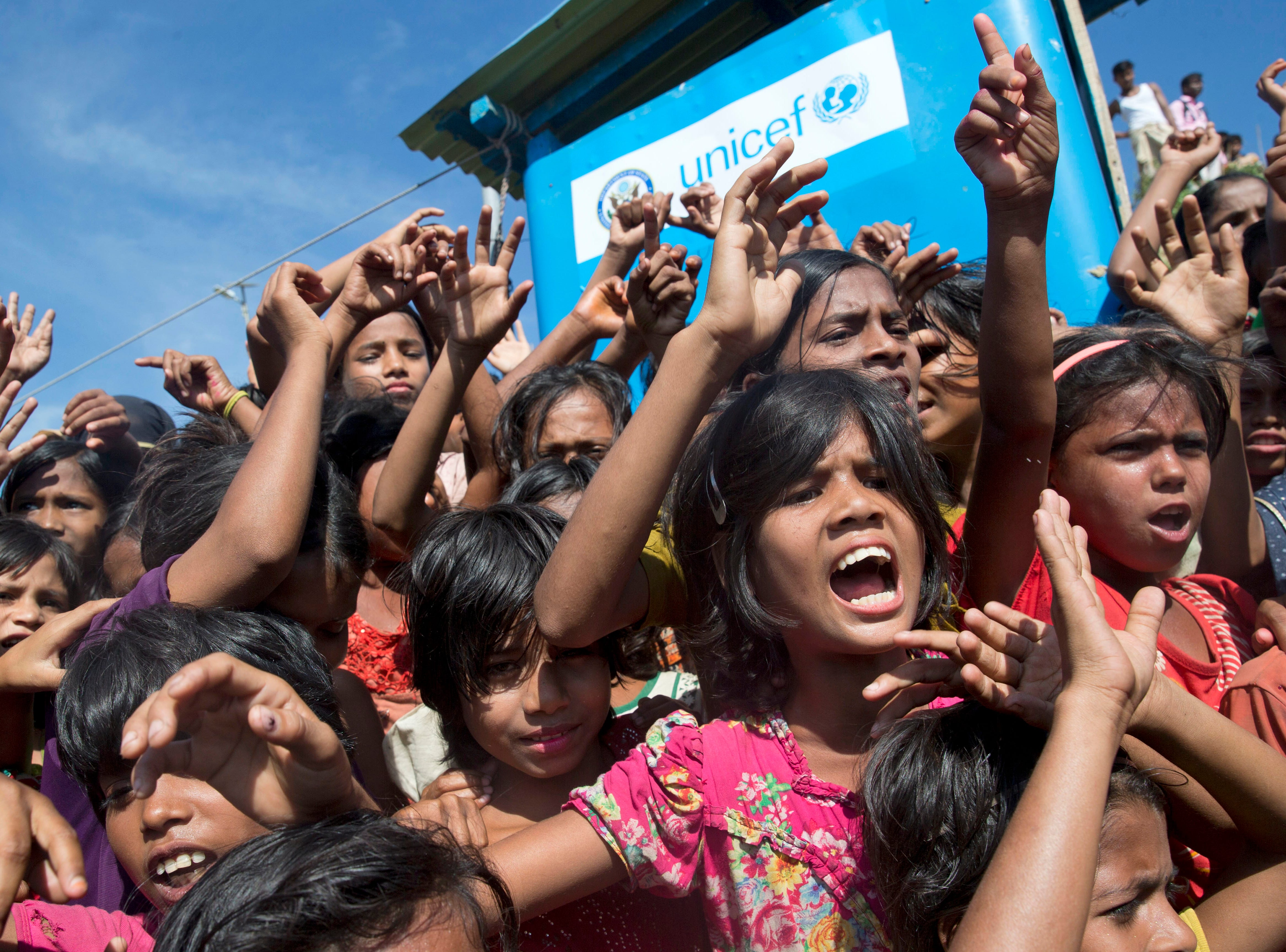 Rohingya refugee children shout slogans during a protest against the repatriation process at Unchiprang refugee camp near Cox's Bazar, in Bangladesh, Thursday, Nov. 15, 2018. The head of Bangladesh's refugee commission said plans to begin a voluntary repatriation of Rohingya Muslim refugees to their native Myanmar on Thursday were scrapped after officials were unable to find anyone who wanted to return.