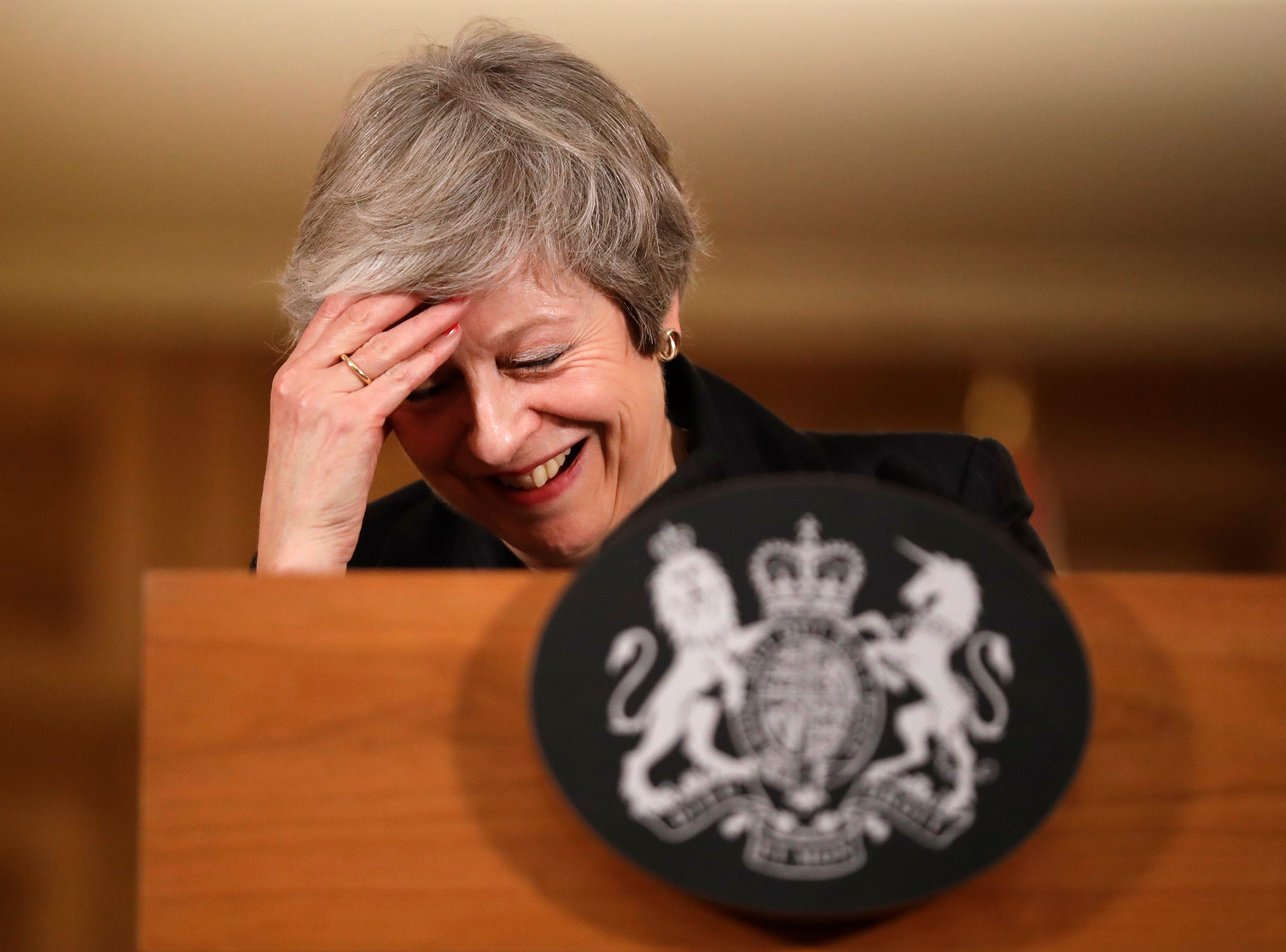 Britain's Prime Minister Theresa May reacts during a press conference inside 10 Downing Street in London, Thursday, Nov. 15, 2018. Two British Cabinet ministers, including Brexit Secretary Dominic Raab, resigned Thursday in opposition to the divorce deal struck by Prime Minister Theresa May with the EU, a major blow to her authority and her ability to get the deal through Parliament.