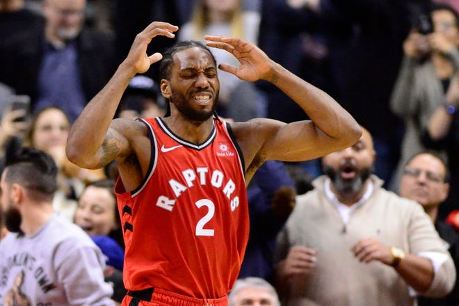 Toronto Raptors forward Kawhi Leonard shows his frustration after dribbling the ball off his foot on Wednesday night against the Detroit Pistons.