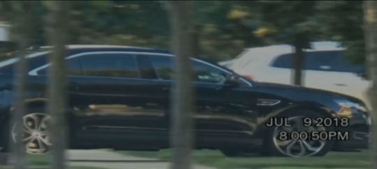 A car identified as Mayor Mike Duggan's is seen arriving at the Novi home of a woman on July 9 in this frame from a secretly recorded video.