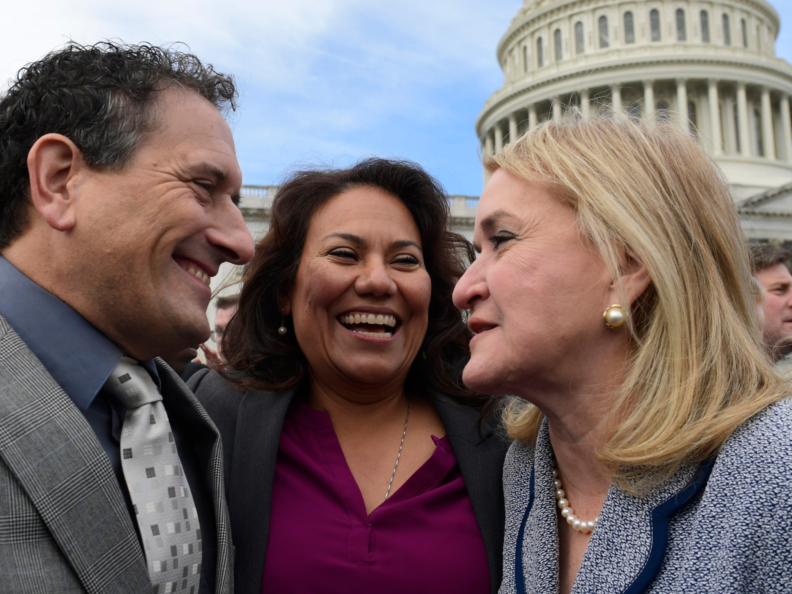 Rep.-elect Andy Levin, D-Mich., left,  Rep.-elect Veronica Escobar, D-Texas, center, and Rep.-elect Sylvia Garcia, D-Texas, right, talk following a photo opportunity on Capitol Hill in Washington, Wednesday, Nov. 14, 2018, for the freshman class.