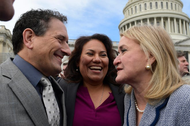 Rep.-elect Andy Levin, D-Bloomfield Township, left, Rep.-elect Veronica Escobar, D-Texas, center, and Rep.-elect Sylvia Garcia, D-Texas, right, talk after the freshman class had its photo taken outside the U.S. Capitol in Washington, Wednesday, Nov. 14, 2018.