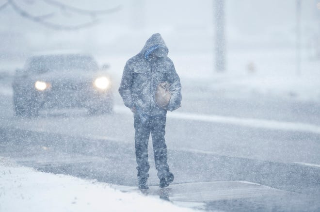Charles Clippard of Evansville heads home for lunch after his shift ended Thursday afternoon. The mixture of sleet and freezing rain ended earlier in the day, but snow began to take its place. Most schools were delayed two hours while some were cancelled for the day.
