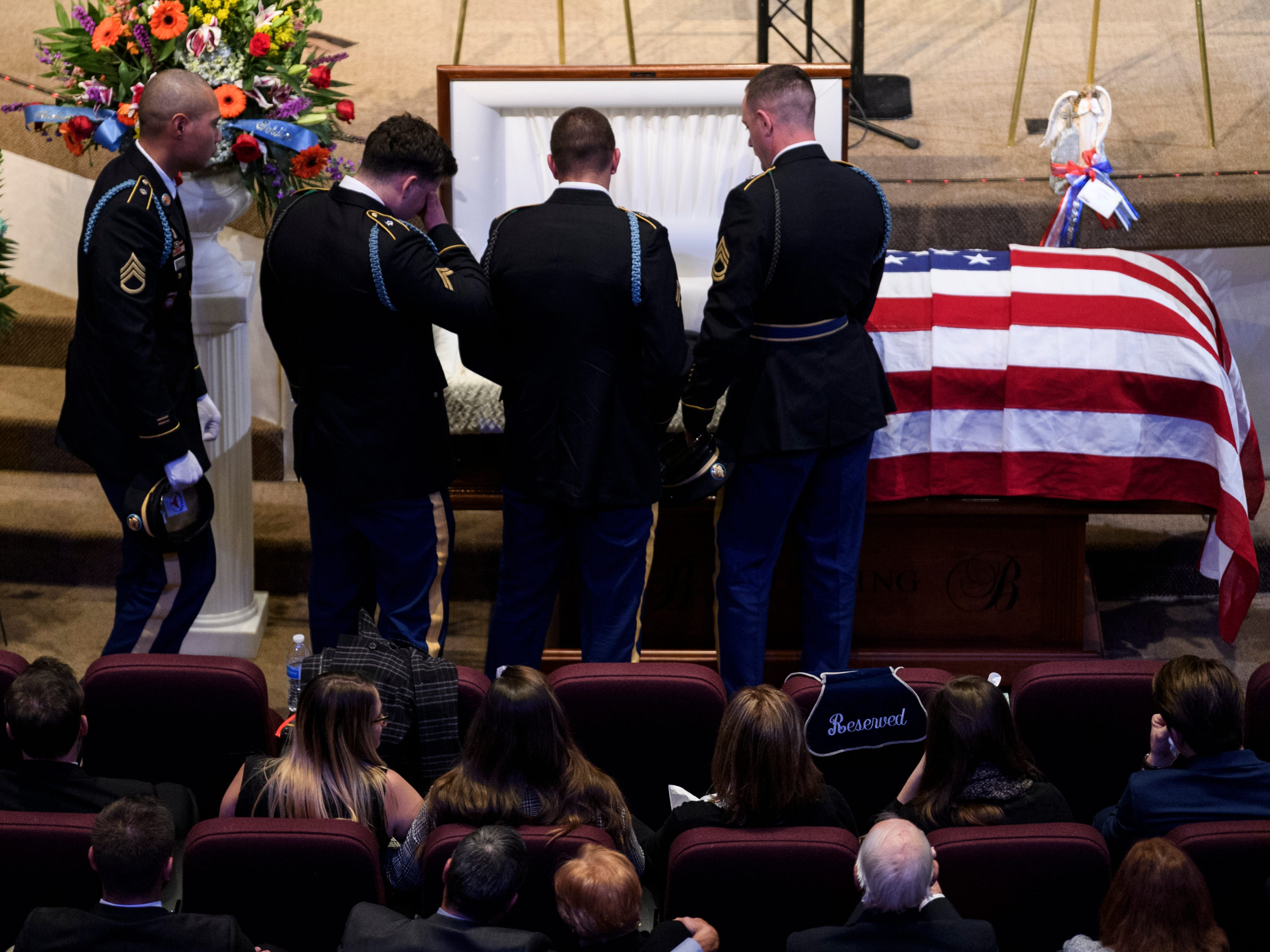 "Soldiers gather together in front of Army Sgt. Drew Watters casket to say goodbye one last time at the ""Celebration of Life"" ceremony held inside Christian Fellowship Church in Evansville, Ind., Wednesday, Nov. 14, 2018."