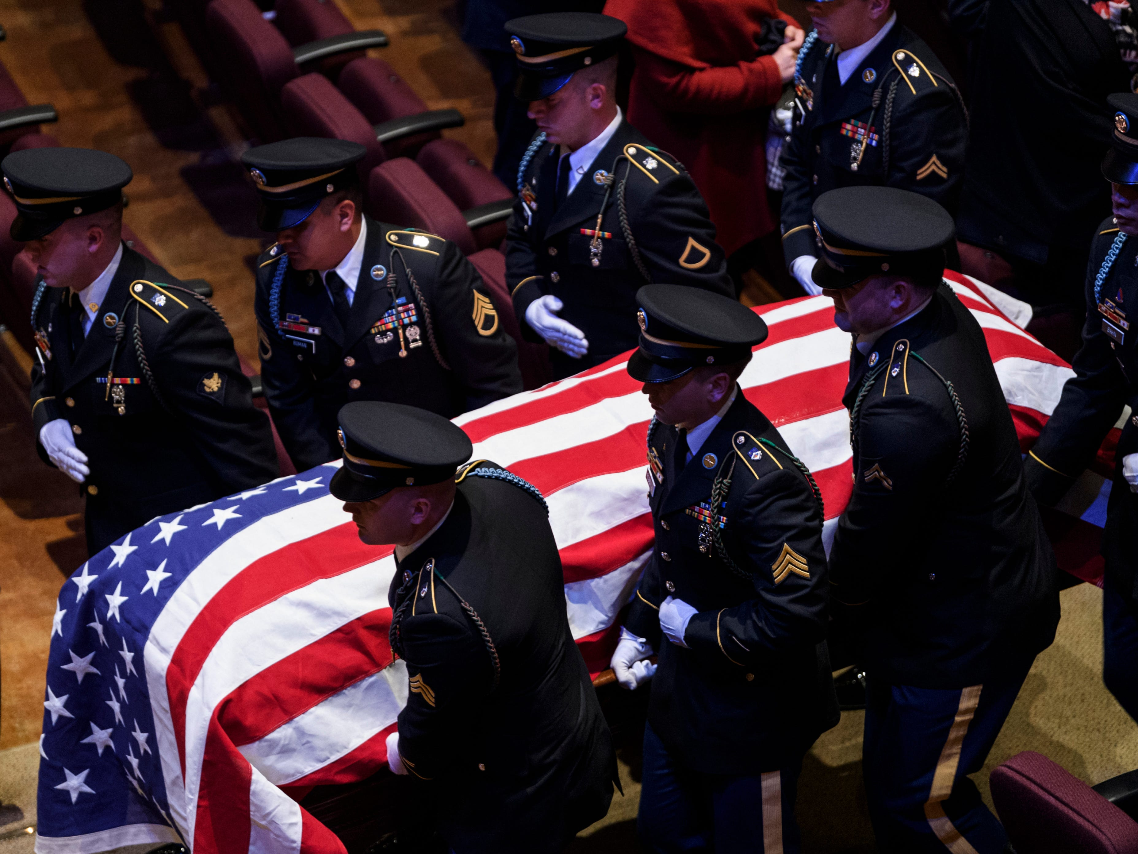 """Soldiers from Joint Base Lewis-McChord in Tacoma, Wash., carry Sgt. Drew Watters' casket out of the Christian Fellowship Church chapel at the end of a """"Celebration of Life"""" ceremony to honor their friend and fellow soldier in Evansville, Ind., Wednesday, Nov. 14, 2018."""