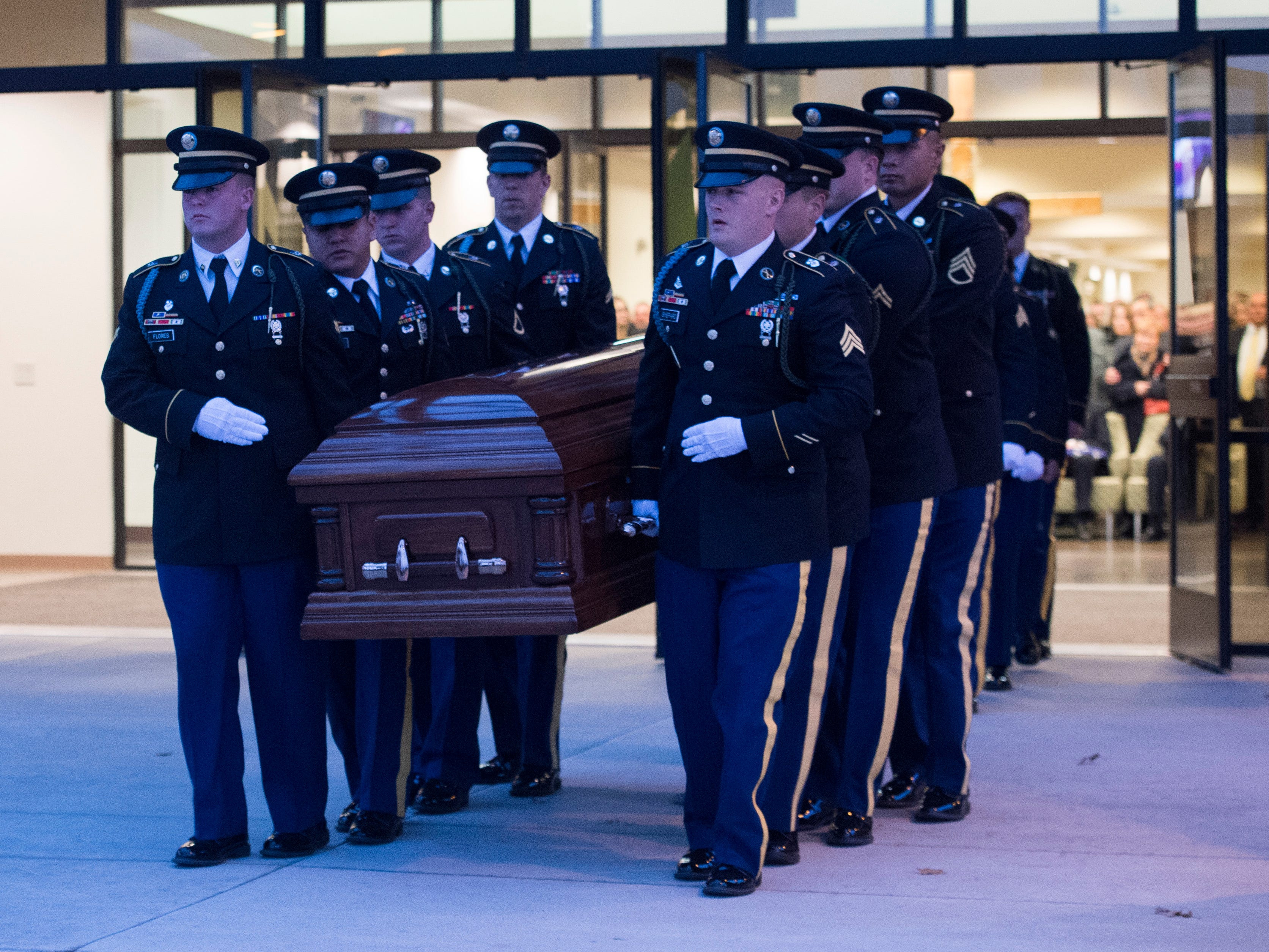 "Fellow soldiers carry the casket of Army Sgt. Drew Watters out of Christian Fellowship Church during a ""Celebration of Life"" ceremony in Evansville, Ind., Wednesday afternoon, Nov. 14, 2018. The 23-year-old Evansville native was killed in a training accident in his Tacoma, Washington, base."