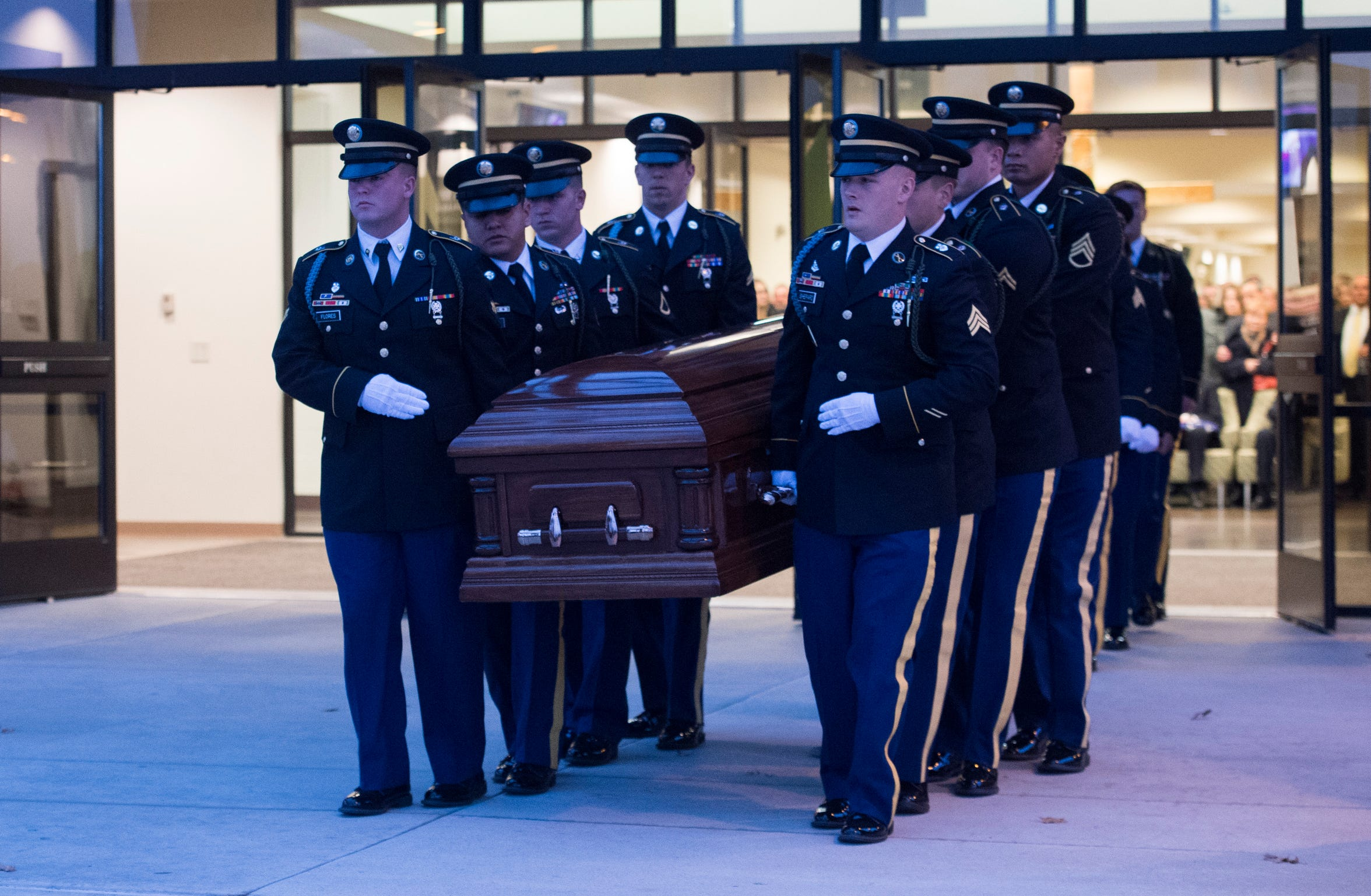 """Fellow soldiers carry the casket of Army Sgt. Drew Watters out of Christian Fellowship Church during a """"Celebration of Life"""" ceremony in Evansville, Ind., Wednesday afternoon, Nov. 14, 2018. The 23-year-old Evansville native was killed in a training accident in his Tacoma, Washington, base."""