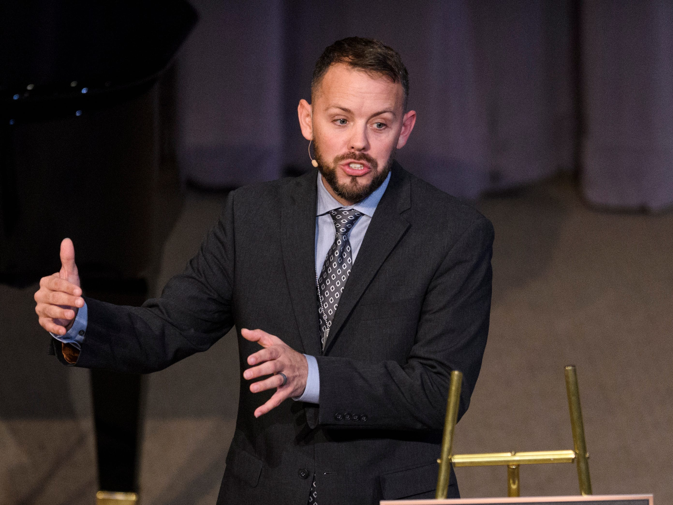 """Rev. Nathan Hazel addresses family and friends of Army Sgt. Drew Watters during the """"Celebration of Life"""" ceremony held for the 23-year-old at Christian Fellowship Church in Evansville, Ind., Wednesday, Nov. 14, 2018."""