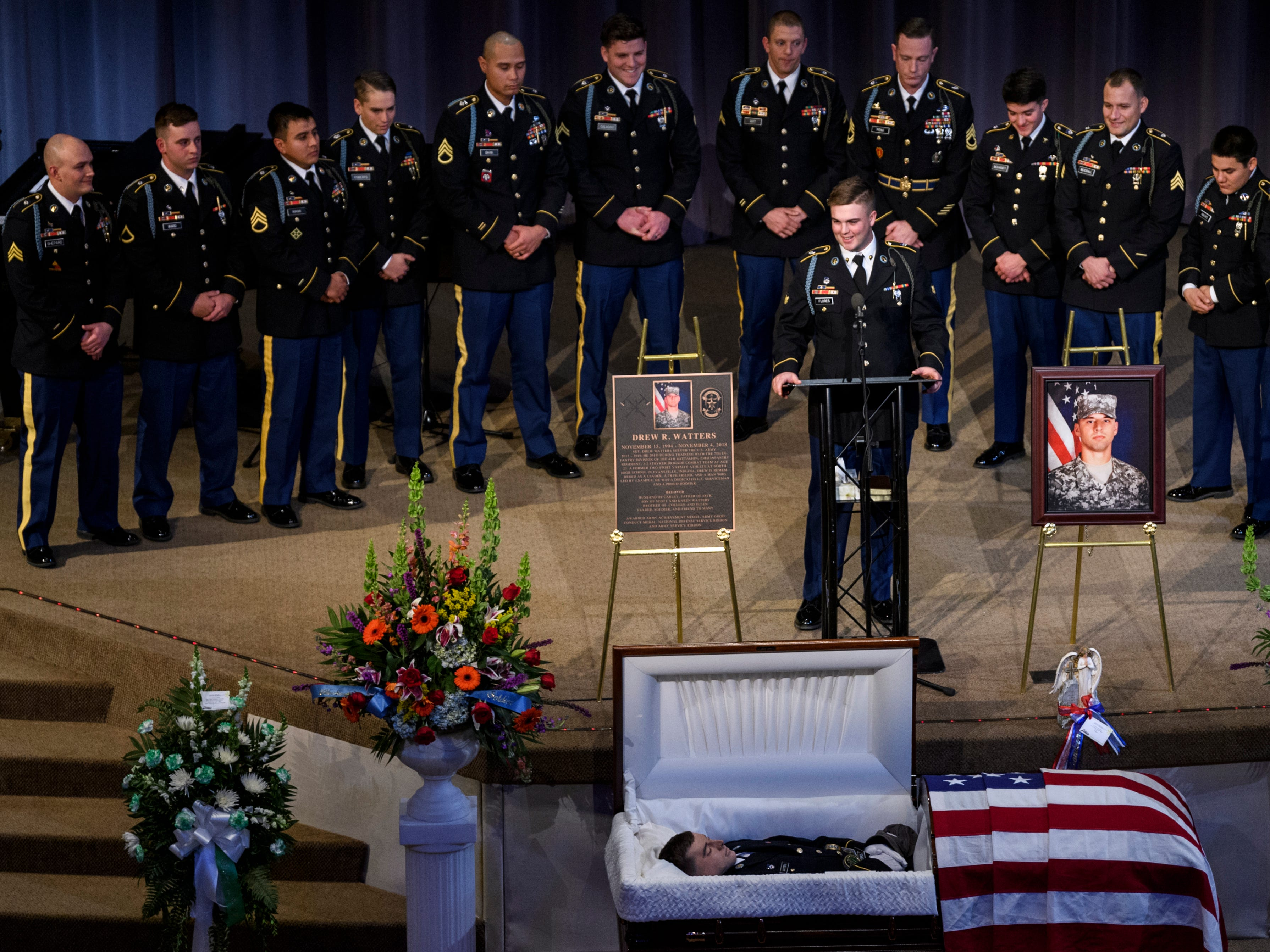 """Army Spc. Flores, center, speaks about his friend and squad mate Sgt. Drew Watters during the """"Celebration of Life"""" ceremony at Christian Fellowship Church in Evansville, Ind., Wednesday, Nov. 14, 2018. """"It's going to be tough but I'll strive to be half the man that Drew was,"""" Flores said."""