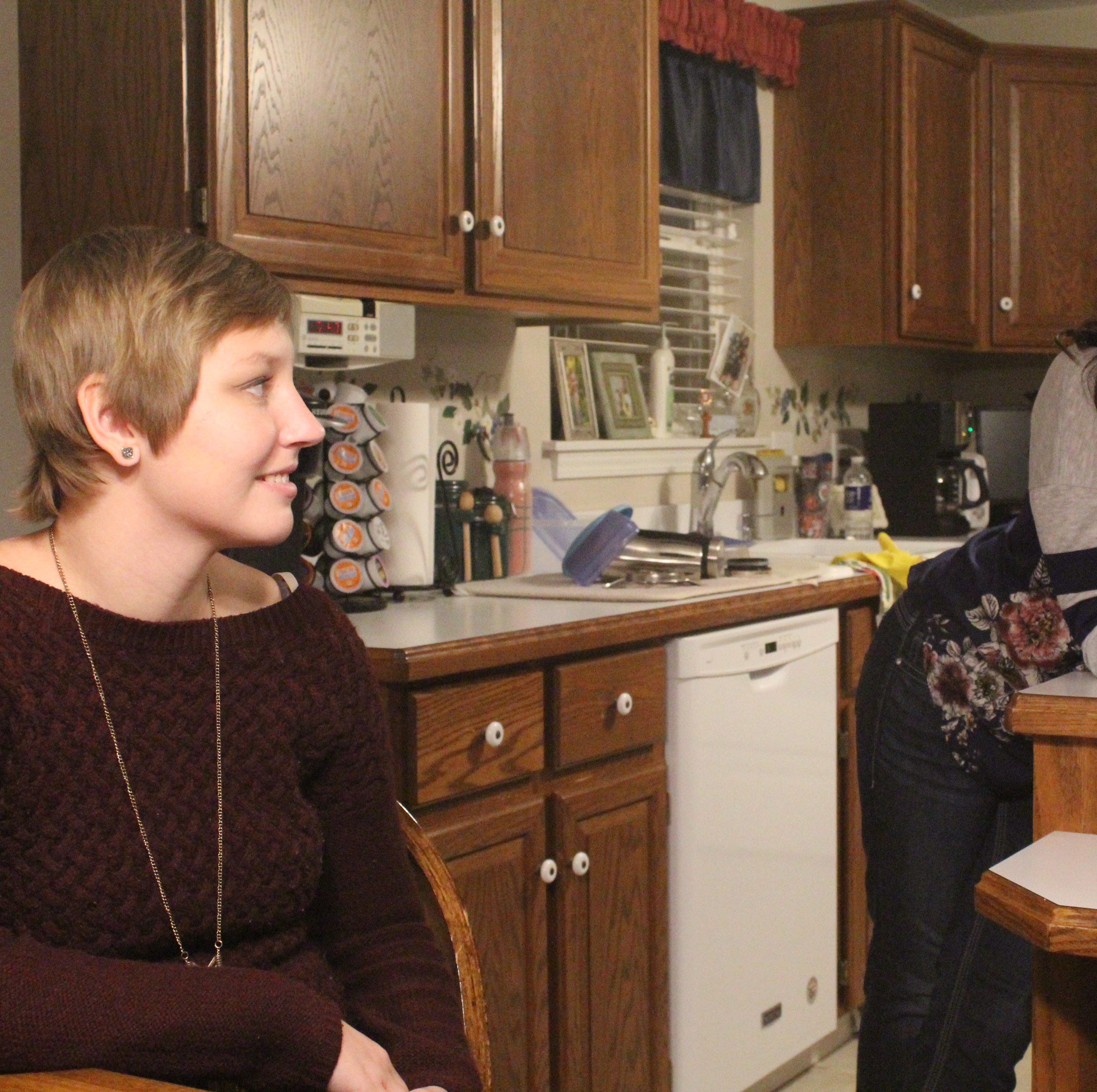 Lexi Evarts and stepmother Jamie Evarts talk in the kitchen before a recent dinner in their Gibsonburg home.