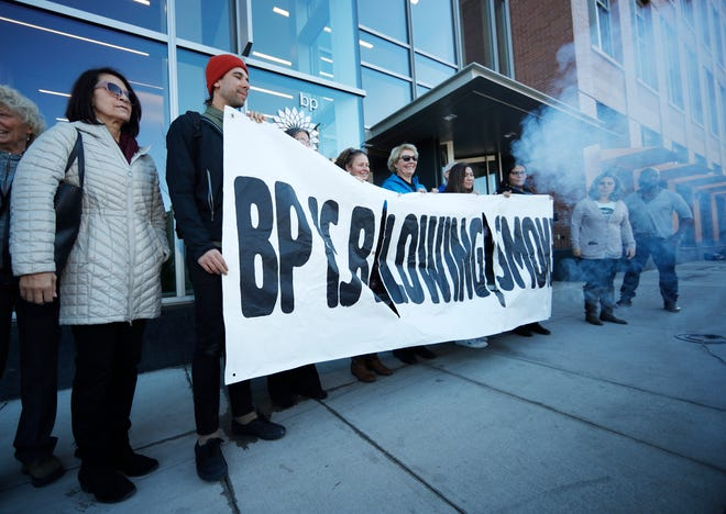 Activists from ProgressNow Colorado, grassroots organizations and stakeholders join forces to demonstrate outside the United States headquarters of BP, Wednesday, Nov. 14, 2018, in Denver. Meanwhile, only blocks to the east, the U.S. Environmental Protection Agency holds its only public hearing on the Trump administration's plans to roll back Obama-era rules for methane pollution from the oil and gas industry. (AP Photo/David Zalubowski)