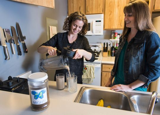 Rachel Bergmans (left) and Tiffany Weir (right) make a milkshake using cricket powder.