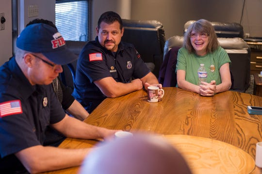 Karen Johnson, right, laughs with firefighters at being interviewed on Tuesday, Nov. 13, 2018, at Poudre Fire Authority Station 5 in Fort Collins, Colo. Johnson, a cashier at King Soopers and friend of the firefighters at the station, was recently given Station 5 firefighter Brian Parker's car, paid for and fixed up by the firefighters at Station 5, after hearing that Johnson was undergoing treatment for cancer and had no vehicle to help her get around.