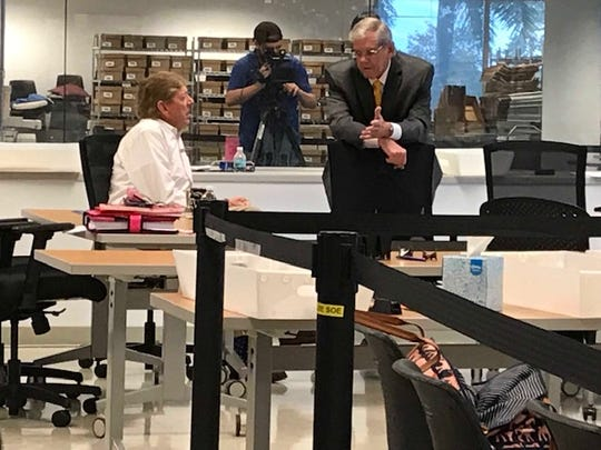 Lee County Supervisor of Elections Tommy Foyle speaks with his counsel, Attorney Tom Hart, before the Lee County canvassing board meeting Thursday. The board was overseeing the resumption of a machine recount of votes in the NOv. 6 mid-term election.