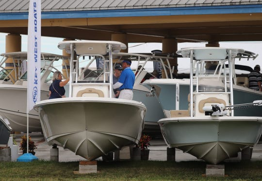 People walk through the Fort Myers Boat Show in downtown Fort Myers in 2018. The show returns this weekend.