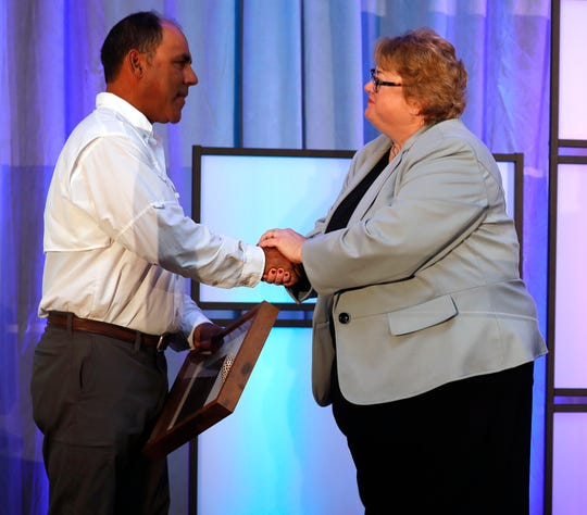 Lee County Visitor & Convention Bureau Executive Director Tamara Pigott congratulates Capt. Brian Holaway, 2018 Junonia Award winner, Thursday, Nov. 15, 2018, at The Westin Cape Coral at Marina Village.