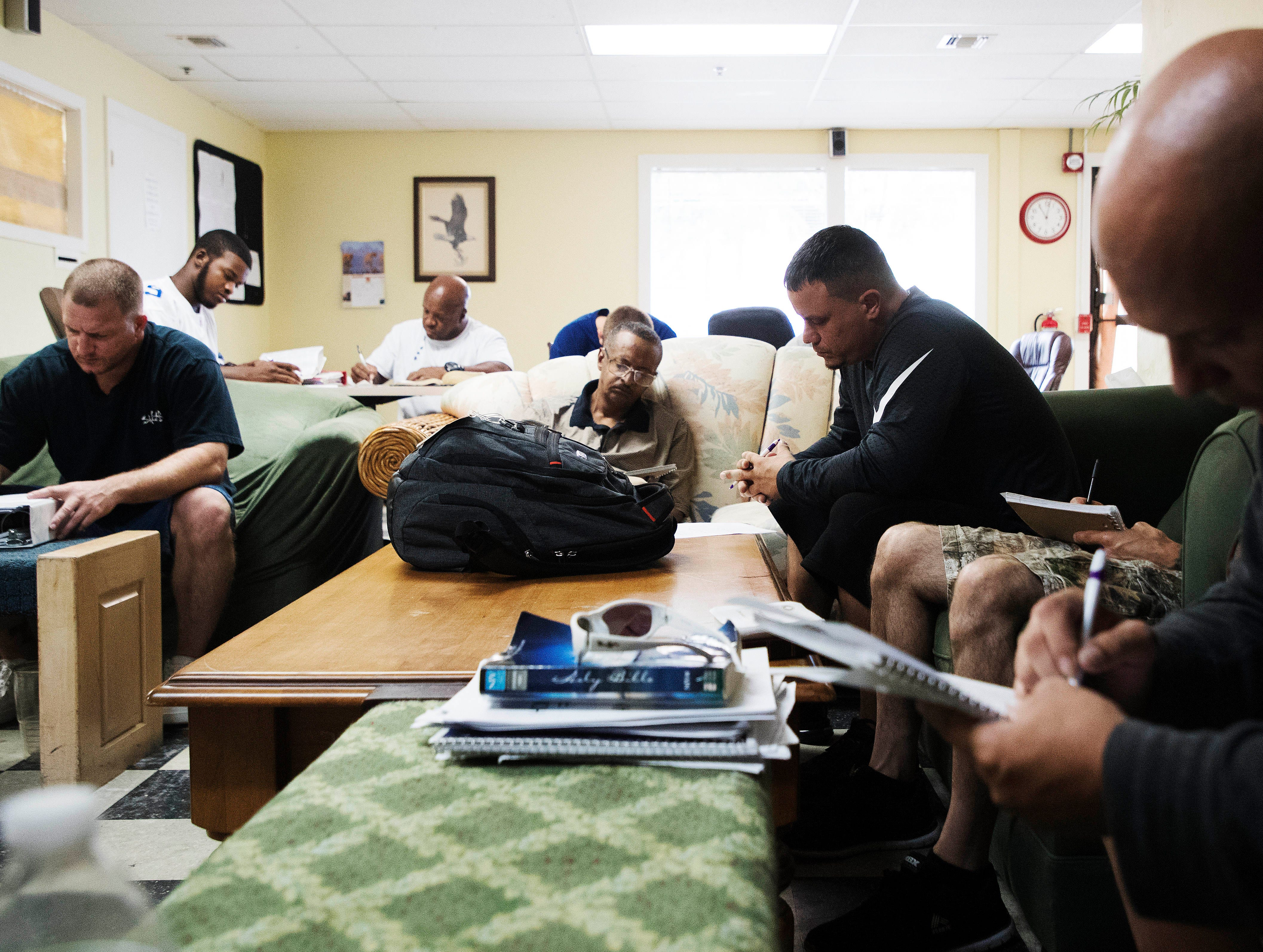 Residents of the New Life Dream Center in Fort Myers take part in a bible study on Tuesday 11/13/2018. The center is a 12 month program for men and women with substance abuse addiction.