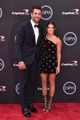 Aaron Rodgers and host Danica Patrick attend the 2018 ESPYS in July in Los Angeles.