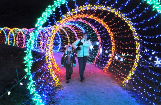 The walk-through caterpillar is a favorite with visitors to Garden of Lights. The structure, a popular stop for photos, gets moved to a different location at Green Bay Botanical Garden each year.
