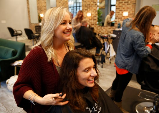 Kristy Ciarla Baumgarner talks with her sister, Kathy Houston, while trimming Houston's hair Wednesday, Nov. 14, 2018.  Ciarla Baumgarner is the owner of,To Dye For, a salon in Greenville, S.C.