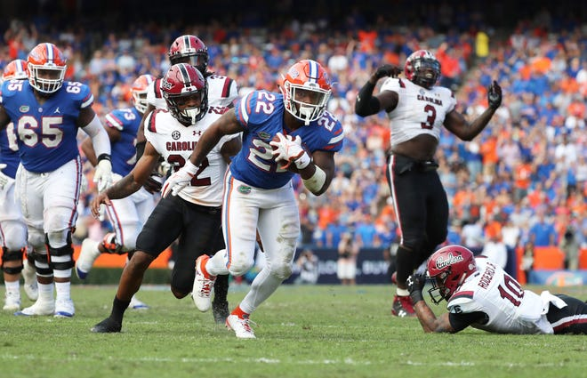 Florida running back Lamical Perine (22) runs the ball in for a touchdown against South Carolina during the second half at Ben Hill Griffin Stadium.