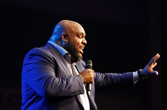 "Pastor John Gray addresses the audience at Relentless Church during the event ""The Bridge - A Conversation on Race, Politics, Culture and the Role of the Church"" Wednesday, Nov. 14, 2018."