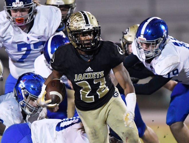 Senior running back Dre Williams (22) and the Greer Yellow Jackets will host York Friday will the second round of the Class AAAA playoffs.