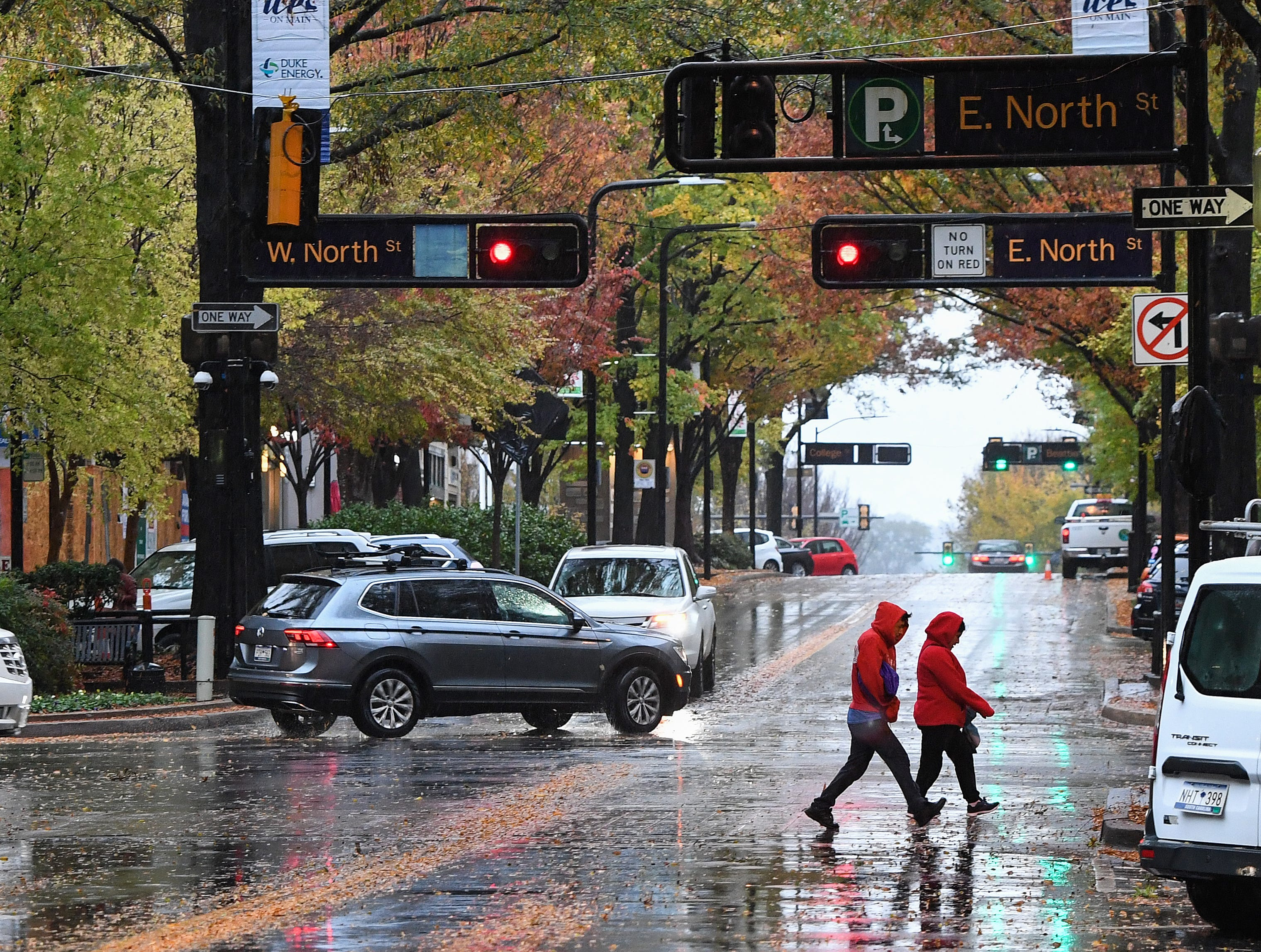 Rain falls on Main St. in downtown Greenville early Thursday, November 15, 2018.