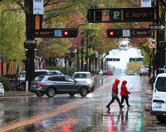 Rain falls on Main St. in downtown Greenville early Thursday, November 15, 2018.