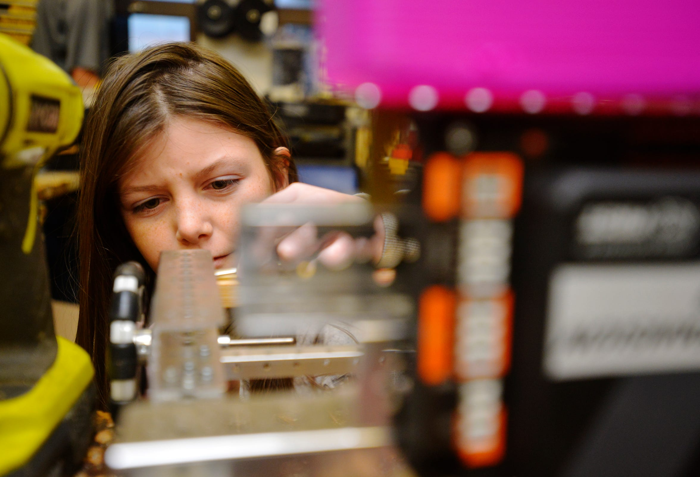Christine Webster, age 12, works on a robot during RedNek Robotics Team meeting recently.