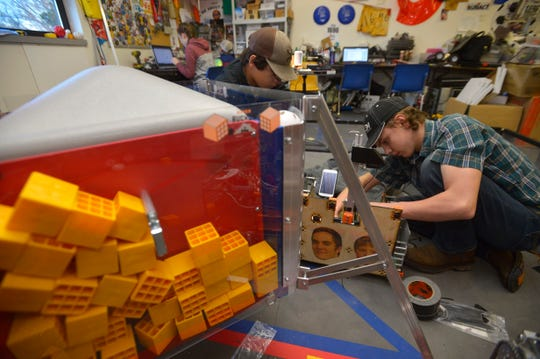 Members of the RedNek Robotics Team in Sun River work on their robot for the FIRST Tech Challenge competition.