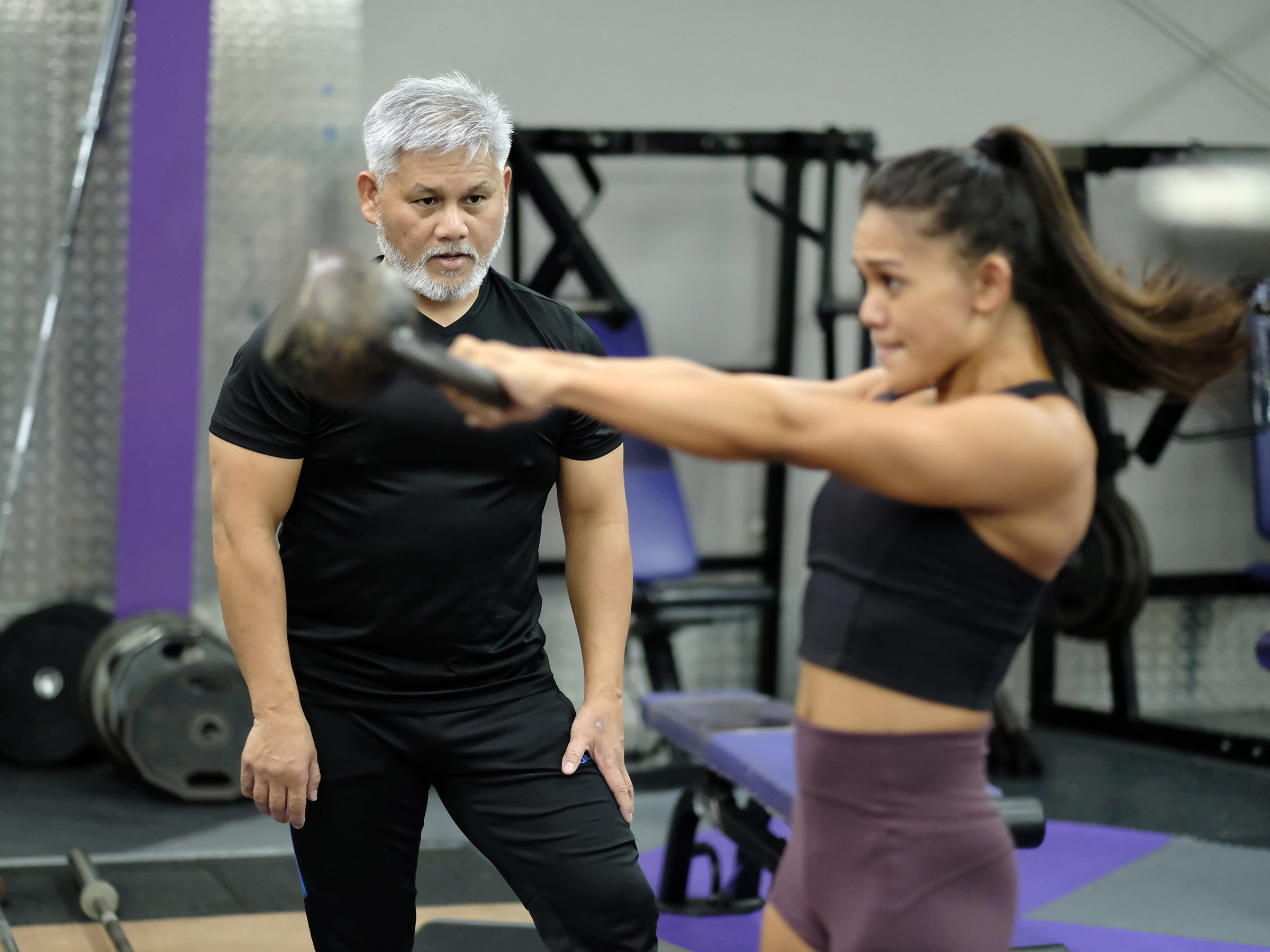Steve Oshiro trains Jeralyn Mesa at Paradise Fitness in Hagatna November 15, 2018. Oshiro has trained many physique and bodybuilding contest winners.