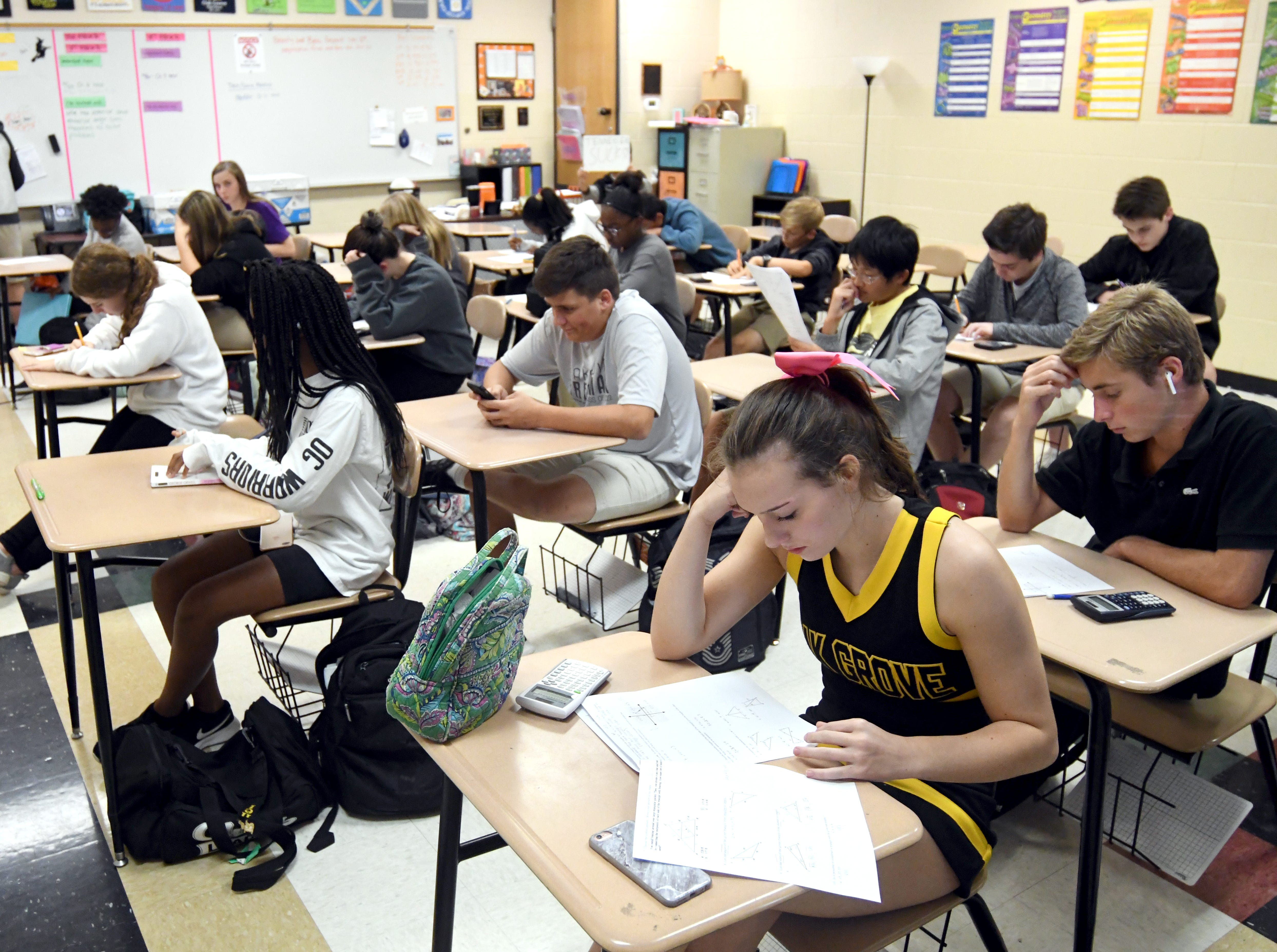Students concentrate during a geometry exam at Oak Grove High School. Oak Grove High School is No. 3 in state in accountability rankings and No. 1 in 6A schools.