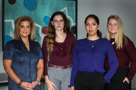 From left, Mara Candelaria Reardon, Niki DaSilva, Samantha Lozano and Gabrielle McLemore are four women who have made accusations of unwanted touching against Attorney General Curtis Hill, seen at the office of Katz Korin Cunningham in Indianapolis, Tuesday, Oct. 30, 2018.