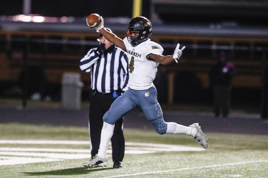 Warren Central wide receiver David Bell (4), celebrates a touchdown during a regional game against North Central, Nov. 9, 2018.