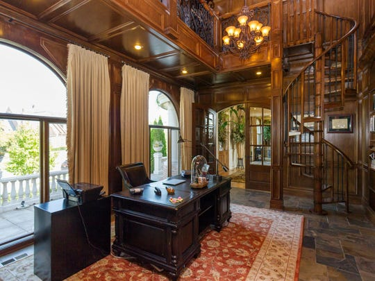 Office and library with spiral staircase, woodwork finishes. The home, in The Bridgewater Club in Hamilton County, was built in 2006 and the owners Kevin and Andrea Welch have put it on the market for $2,000,000.