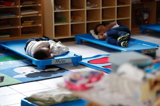 Children nap in the child and youth development center at Flanner House in Indianapolis on Thursday, Nov. 15, 2018.