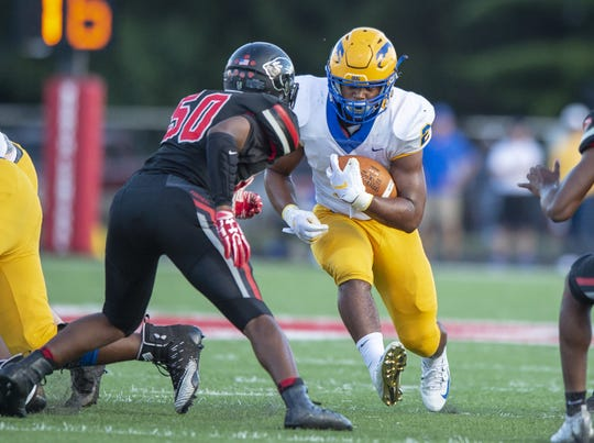 FILE – Carmel junior Dylan Downing (2) rushed for 159 yards on 24 carries in a 20-6 win over Fort Wayne Snider last week.