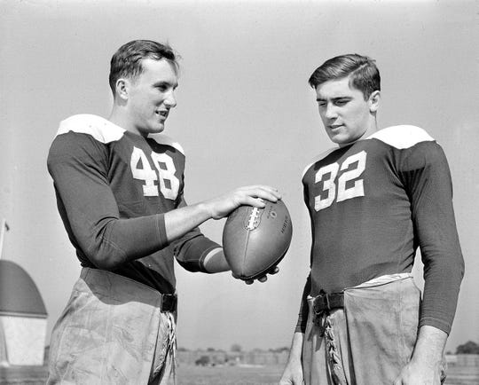 Notre Dame quarterback Angelo Bertelli handed off his position to Johnny Lujack.