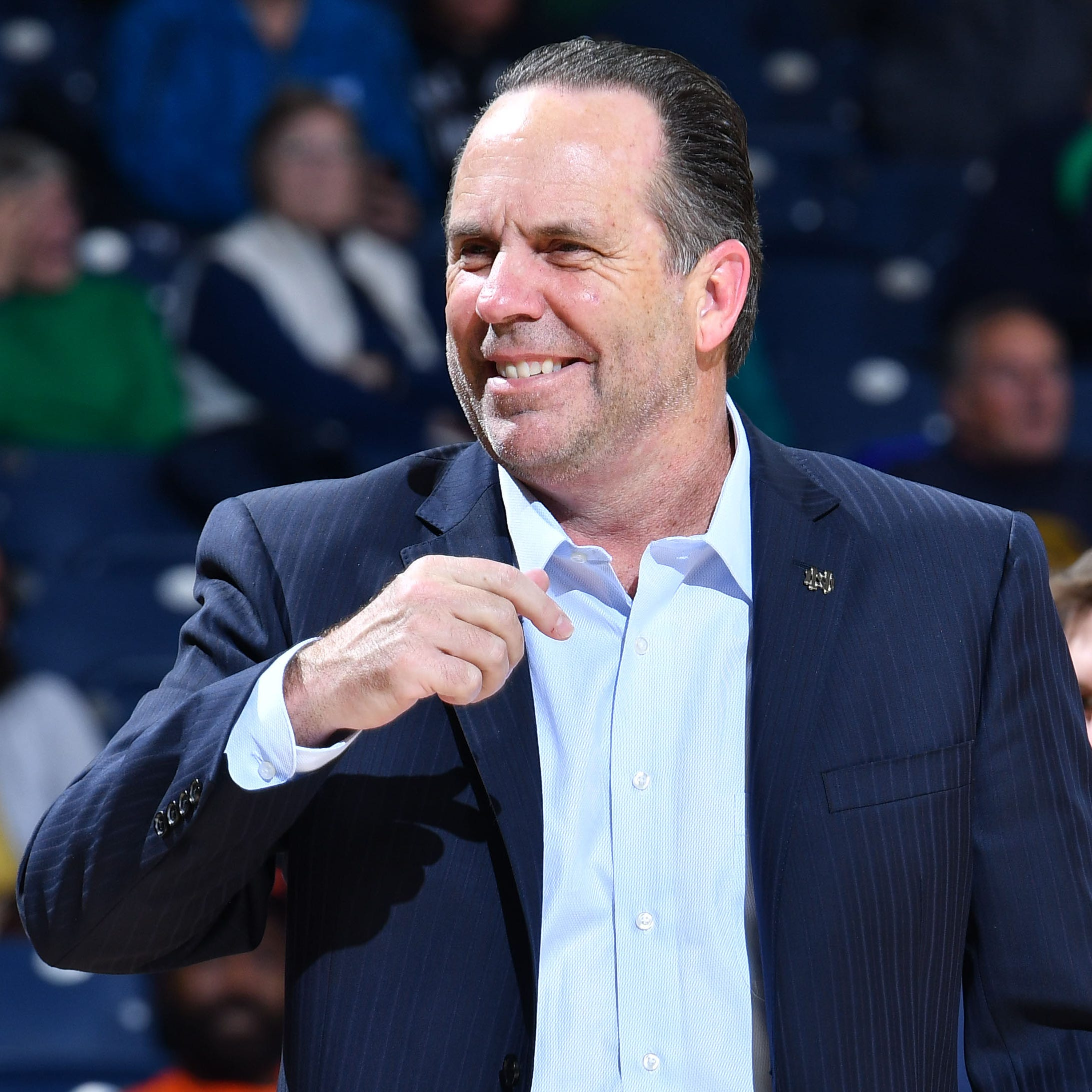 FILE -- Notre Dame Fighting Irish head coach Mike Brey smiles in the second half against the Chicago State Cougars at the Purcell Pavilion.