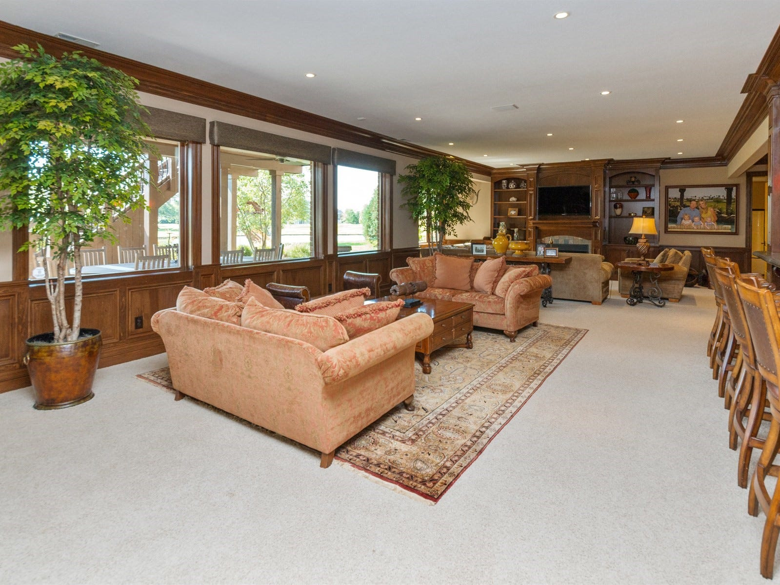 Finished basement features a theater, wet bar, billiards room and two guest rooms