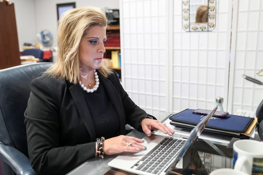 Rep. Mara Candelaria Reardon, a Democrat from Munster, Ind., works in her office at the Indiana Statehouse in Indianapolis, Thursday, Nov. 8, 2018.